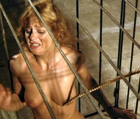 caged prisoner getting a breast whipping