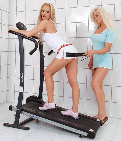 hot blonde personal trainer spanks another sexy blonde on a treadmill